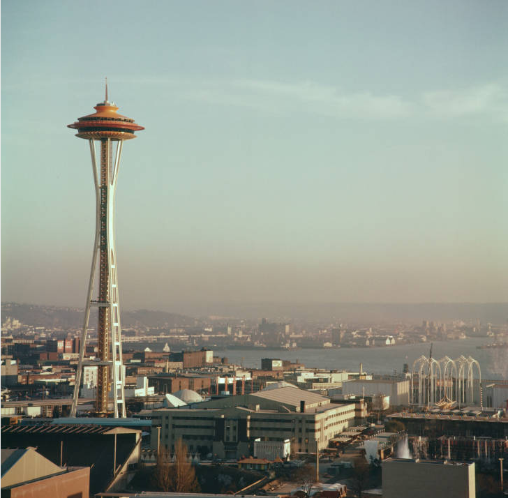 View south to Space Needle and fairground, 1962. Workers preparing ground for Space Needle foundation, ca. April 1961. Photo by by George Gulacsik, image courtesy of the Seattle Public Library