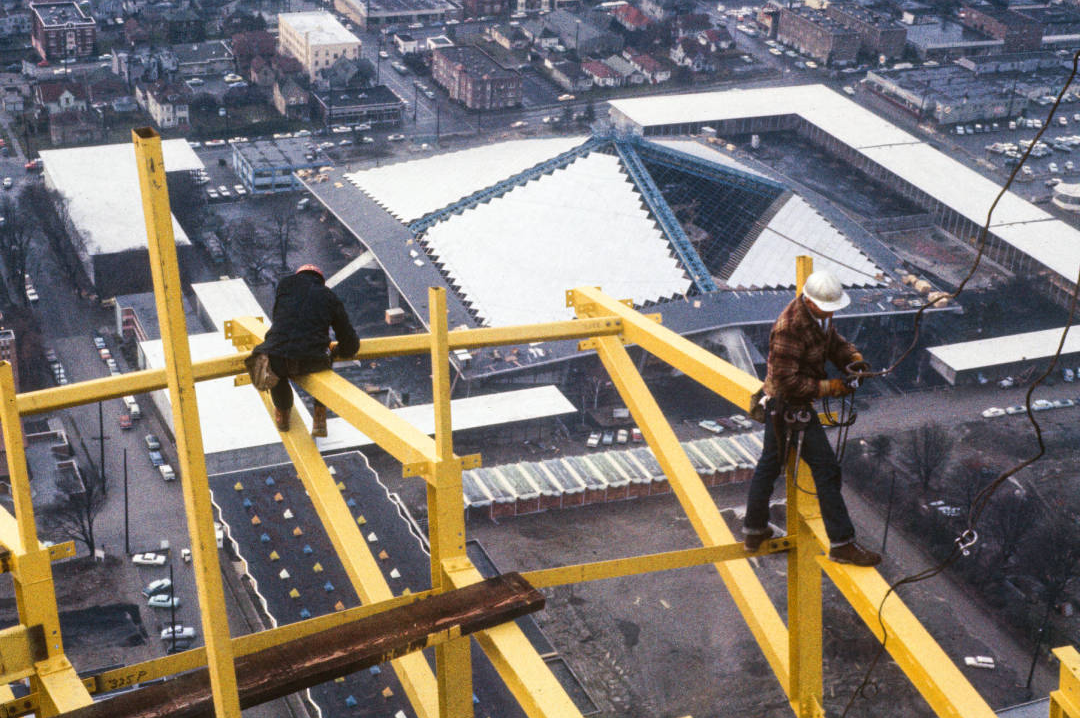 Workers on Space Needle outrigger fins, ca. December 1961. Workers preparing ground for Space Needle foundation, ca. April 1961. Photo by by George Gulacsik, image courtesy of the Seattle Public Library