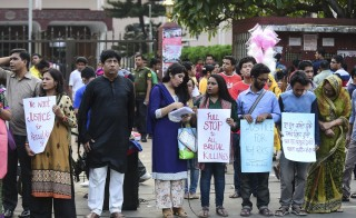 A string of killings have targeted bloggers, activists and professors in Bangladesh. Bangladeshi protesters and former Rajshahi University students hold placards and form a human chain during a demonstration against the killing of a university professor in Dhaka on April 29, 2016. Photo by STR/AFP/Getty Images