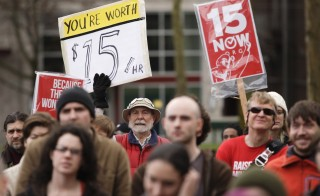 SEATTLE -- The U.S. Supreme Court will not hear a challenge to Seattle's $15-an-hour minimum wage from franchise owners who say the law discriminates against them by treating them as large businesses.  People rally in support of a $15 minimum wage at Seattle Central Community College in Seattle, Washington March 15, 2014. Voters in SeaTac, Washington recently passed a ballot initiative for $15 minimum wage. Photo by Jason Redmond/Reuters