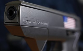 "A smart gun by Armatix is pictured at the Armatix headquarters in Munich May 14, 2014. The gun is implanted with an electronic chip that allows it to be fired only if the shooter is wearing a watch that communicates with it through a radio signal. If the gun is moved more than 10 inches (25 cm) from the watch, it will not fire. A Maryland gun shop owner has dropped his plan to be the first in the United States to sell the so-called ""smart gun"" after a backlash that included death threats.     REUTERS/Michael Dalder       (GERMANY - Tags: CRIME LAW POLITICS SCIENCE TECHNOLOGY BUSINESS) - RTR3P2S3"
