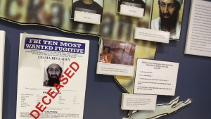 "The FBI's Ten Most Wanted Fugitive poster for Osama Bin Laden with the word ""DECEASED"" printed in red across it hangs on the wall at the FBI Headquarters in Washington, November 26, 2013.  REUTERS/Larry Downing   (UNITED STATES - Tags: POLITICS CIVIL UNREST MILITARY) - RTX15U8F"