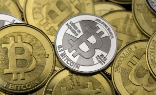 Some of Bitcoin enthusiast Mike Caldwell's coins are pictured at his office in this photo illustration in Sandy, Utah. Photo by Jim Urquhart/Reuters