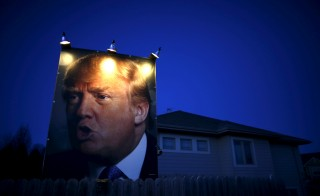 A picture of Republican presidential candidate Donald Trump hangs outside a house in West Des Moines, Iowa. Photo by Jim Young/Reuters