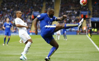 """Football Soccer - Leicester City v Swansea City - Barclays Premier League - The King Power Stadium - 24/4/16 Leicester City's Wes Morgan in action with Swansea's Wayne Routledge Reuters / Darren Staples Livepic EDITORIAL USE ONLY. No use with unauthorized audio, video, data, fixture lists, club/league logos or """"live"""" services. Online in-match use limited to 45 images, no video emulation. No use in betting, games or single club/league/player publications.  Please contact your account representative for further details. - RTX2BFC9"""