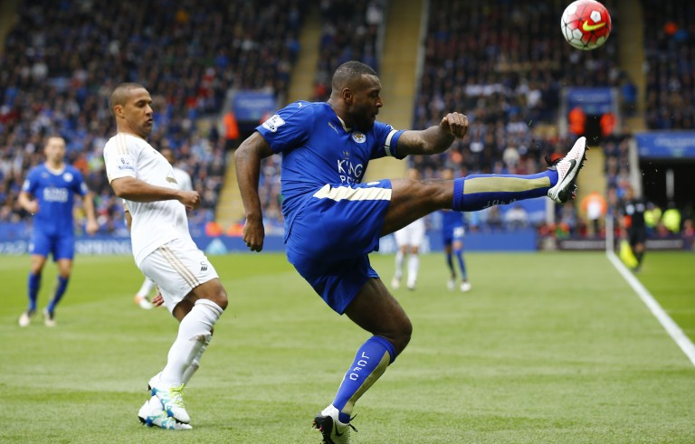 "Football Soccer - Leicester City v Swansea City - Barclays Premier League - The King Power Stadium - 24/4/16 Leicester City's Wes Morgan in action with Swansea's Wayne Routledge Reuters / Darren Staples Livepic EDITORIAL USE ONLY. No use with unauthorized audio, video, data, fixture lists, club/league logos or ""live"" services. Online in-match use limited to 45 images, no video emulation. No use in betting, games or single club/league/player publications.  Please contact your account representative for further details. - RTX2BFC9"