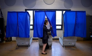 A voter leaves the booth after casting her ballot in the Pennsylvania primary at a polling place in Philadelphia on April 26. Photo by Charles Mostoller/ Reuters