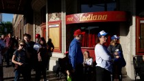 People stand outside Indiana Theater to hear U.S. Republican presidential candidate Donald Trump speak at a campaign event in Terre Haute, Indiana, U.S., May 1, 2016.  REUTERS/Aaron P. Bernstein - RTX2CCS0