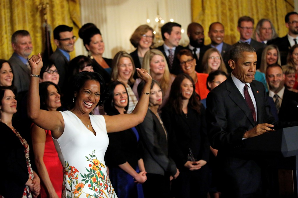Jahana Hayes (L), awarded the 2016 National Teacher of the Year, reacts as U.S. President Barack Obama delivers remarks during a ceremony at the White House in Washington, D.C. Photo by Carlos Barria/Reuters
