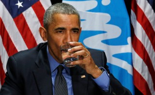 President Barack Obama drinks a glass of filtered water from Flint, a city struggling with the effects of lead-poisoned drinking water, during a meeting will local and federal authorities in Michigan. Photo by Carlos Barria/Reuters