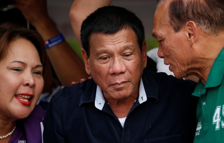 Filipino presidential candidate Rodrigo Duterte (center) listens to senatorial candidates Dionisio Santiago (right) and Sandra Cam during a campaign event in Malabon, Metro Manila in the Philippines on April 27. Photo by Erik De Castro/Reuters