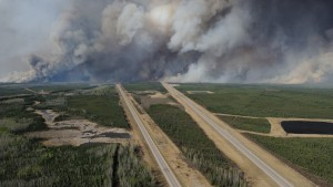 An aerial view of Highway 63 south of Fort McMurray, Alberta. Canada, shows smoke from the wildfires taken from a CH-146 Griffon helicopter May 5, 2016.  MCPL VanPutten/Canadian Armed Forces/Handout via Reuters   ATTENTION EDITORS - THIS IMAGE WAS PROVIDED BY A THIRD PARTY. EDITORIAL USE ONLY - RTX2D6CH