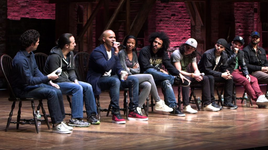 "Members of the cast of ""Hamilton"" meet on stage April 13, 2016 to answer questions posed by New York City high schools students. Photo By PBS NewsHour"
