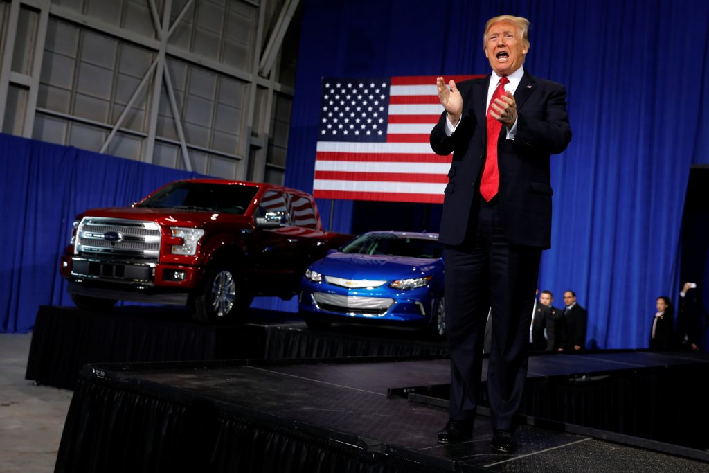 U.S. President Donald Trump takes the stage to deliver remarks at the American Center for Mobility, a test facility for driverless car technology for American Manufactured Vehicles in Ypsilanti Township