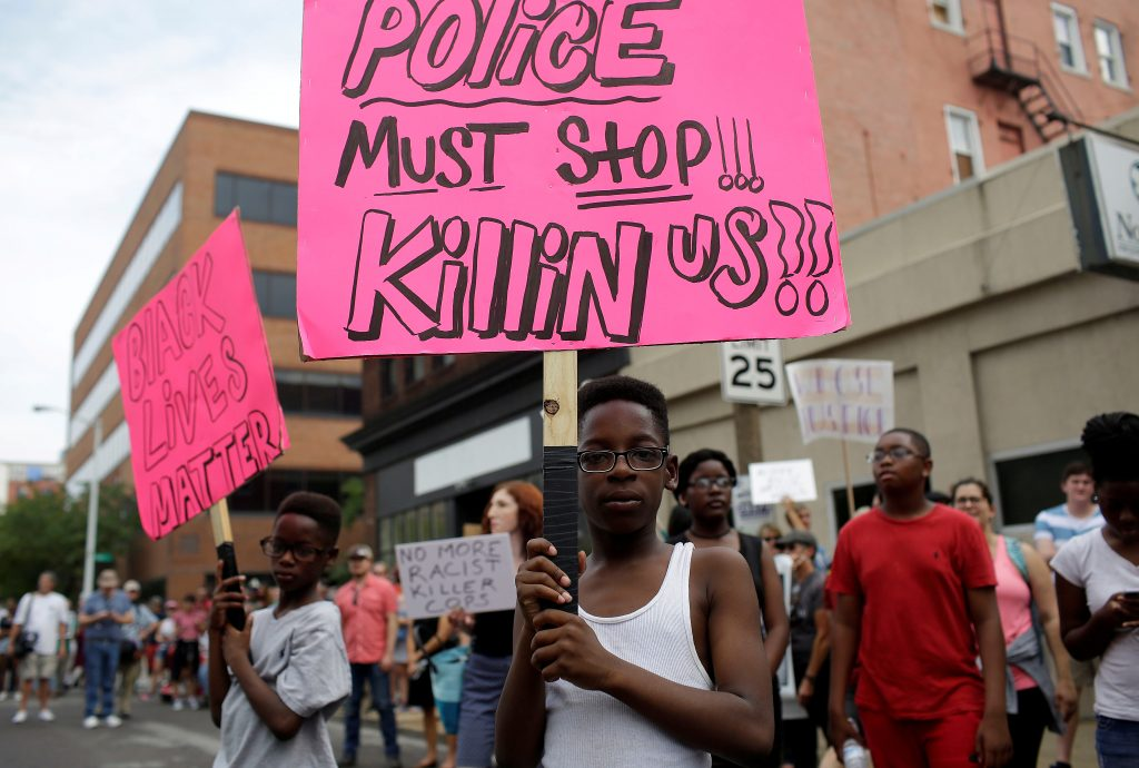 People continue to march after the not guilty verdict in the murder trial of Jason Stockley, a former St. Louis police officer, charged with the 2011 shooting of Anthony Lamar Smith, who was black, in St. Louis, Missouri. Photo by Joshua Lott/Reuters