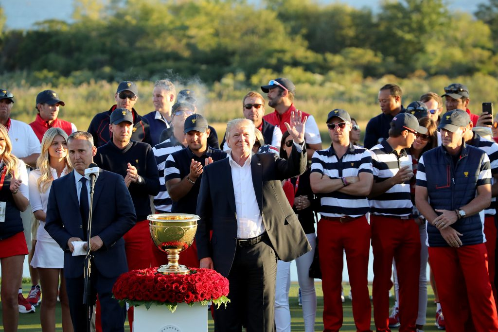President Trump prepares to present the victorious United States team Captain Steve Stricker with the Presidents Cup after the US won by 19-11  during the final day singles matches in the 2017 Presidents Cup.  Photo by David Cannon/Getty Images