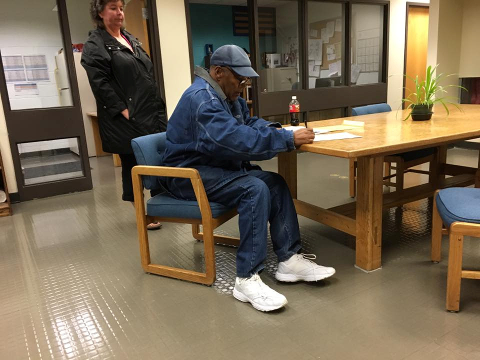 O.J. Simpson signs documentation at Lovelock Correctional Center, Nevada, U.S. as he is released on parole