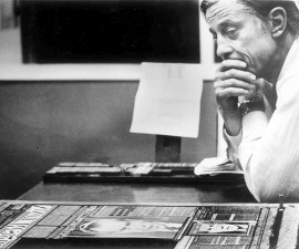 """The Wshington Post's Ben Bradlee in the composing room looking at A1 of the first edition, headlined """"Nixon Resigns."""" Bradlee died Tuesday at the age of 93. Photo by David R. Legge/The Washington Post via Getty Images"""