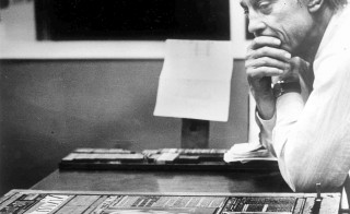 "The Wshington Post's Ben Bradlee in the composing room looking at A1 of the first edition, headlined ""Nixon Resigns."" Bradlee died Tuesday at the age of 93. Photo by David R. Legge/The Washington Post via Getty Images"