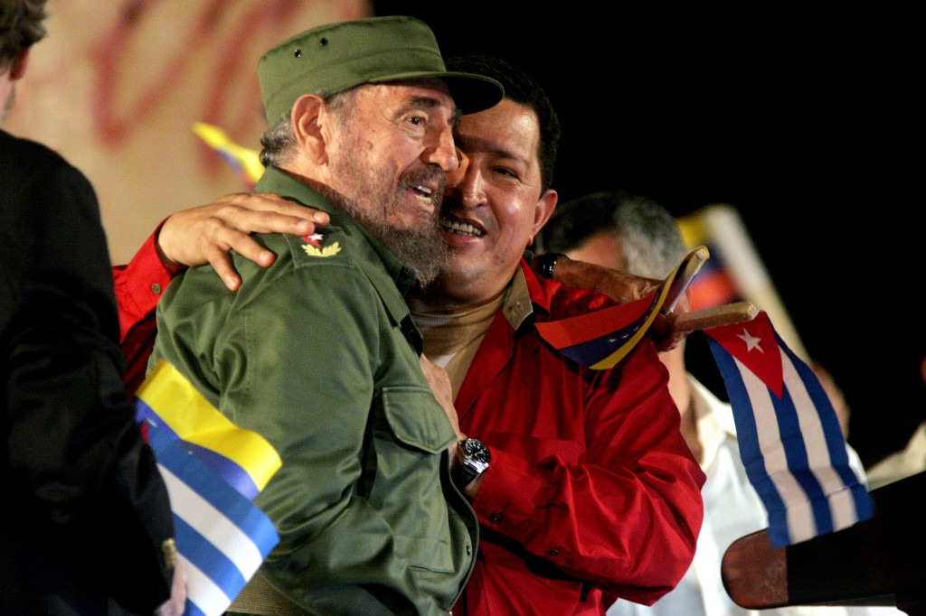 Hugo Chavez, President of Venzuela, embraces Fidel Castro after Chavez spoke in Havana in February 2006. Photo by Sven Creutzmann/Mambo Photography/Getty Images