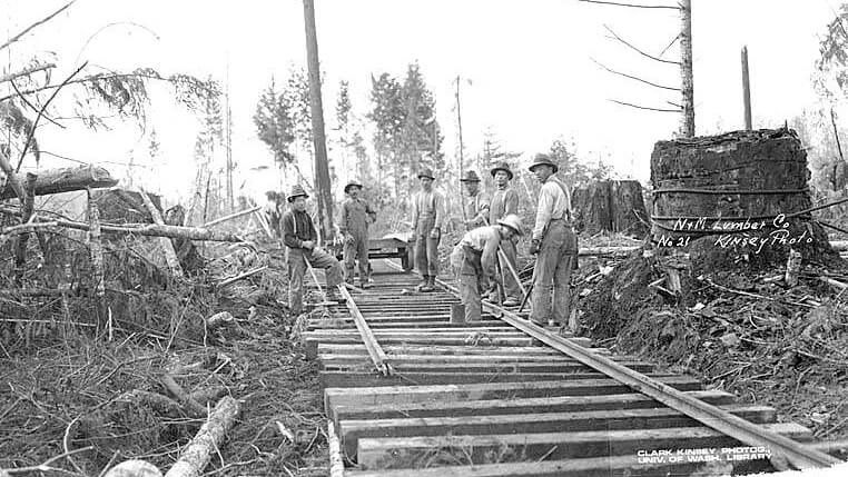 Asian railroad construction crew at work