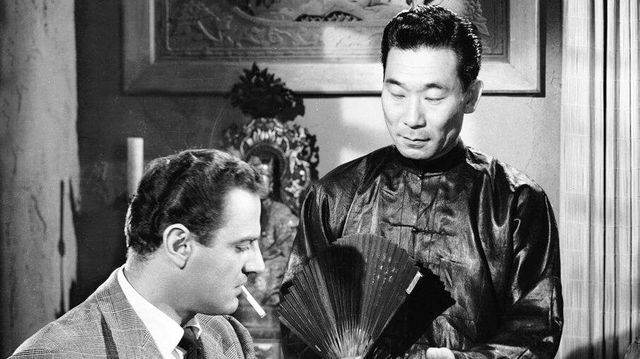 Brad Dexter and Philip Ahn in the 1952 film Macao