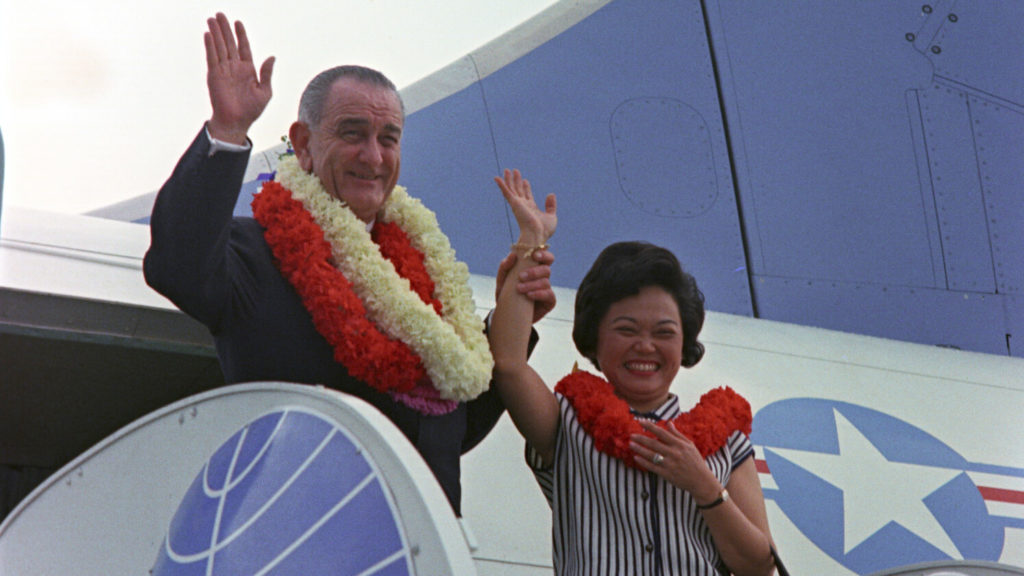 Congresswoman Patsy Mink of Hawaii stands next to President Lyndon B. Johnson