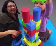 Woman and child build tower