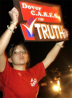girl holding 'truth' sign