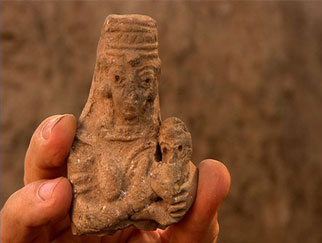 Small clay figurine.