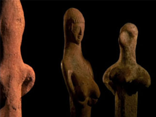 Three clay figurines.