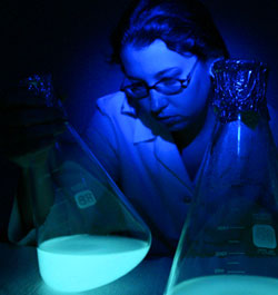 Lab worker with bioluminescent sample