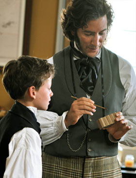 Charles Darwin and son in study
