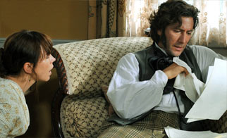 Charles reading letter with Emma