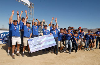 Stanley's team cheering with their winnings after the truck placed first at the 2005 Grand Challenge