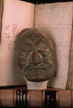 Newton's death mask propped up against some old books