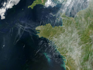 Contrails looking like wispy clouds over northwestern Europe