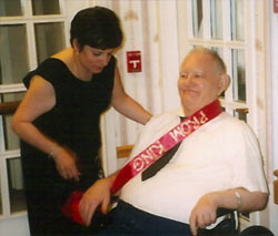 H.M., smiling, in a nursing home