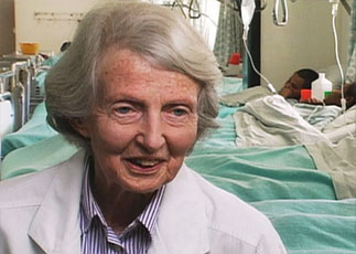 Catherine Hamlin, with the recovery room in the background