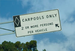 gas-electric hybrid vehicle under carpool sign