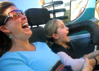 A woman and child enjoying a rollercoaster.