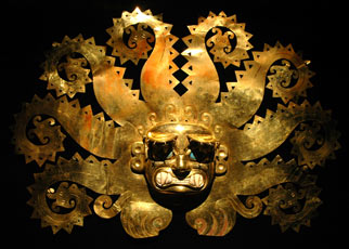 An ornate, gold Peruvian mask.