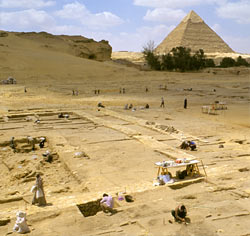 A excavation site with an Egyptian pyramid in the background
