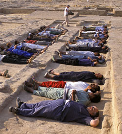 Field workers demonstrating how pyramid builders would have slept