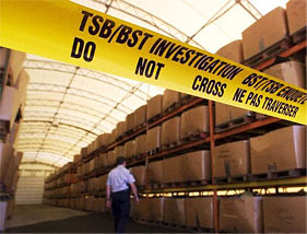 Boxes stacked on shelves, containing fragments from a plane crash