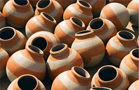 Orange and white striped ceramic pots
