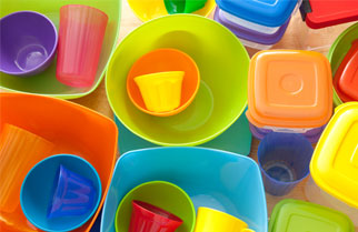 Brightly colored plastic cups, bowls and tubs
