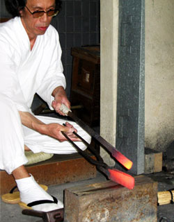 Gassan Sadatoshi preparing metal for a samurai sword