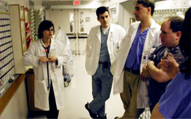 Finkel, Tancredi, and other doctors discussing the patients