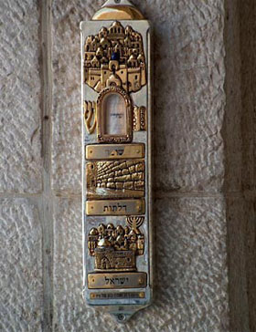A mezuzah near a doorway.